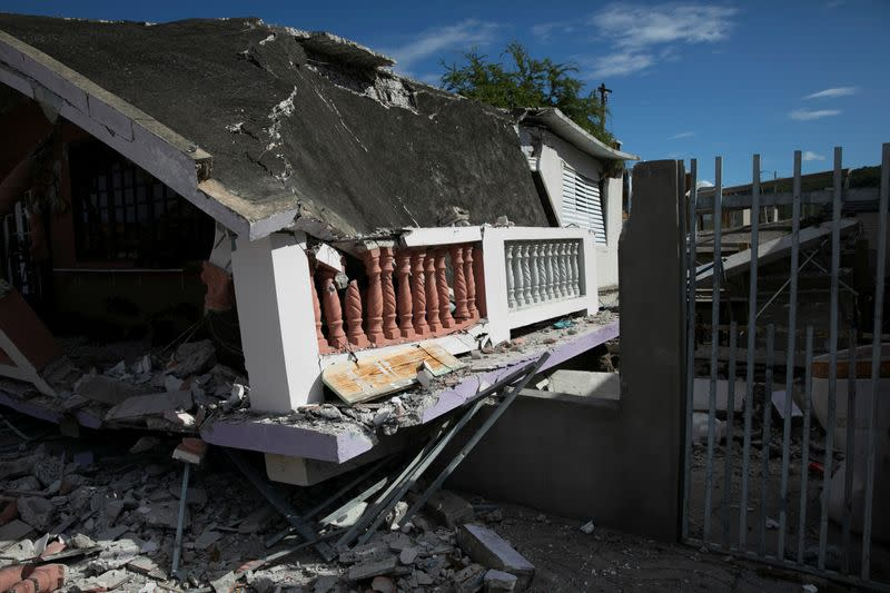 A house that collapsed on its foundation is seen after an earthquake in Guanica
