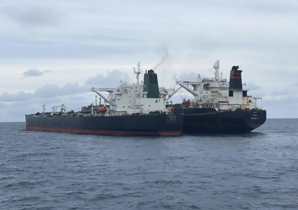 In this photo released by Indonesian Maritime Security Agency (BAKAMLA), Iranian-flagged MT Horse, left, and Panamanian-flagged MT Frea tankers are seen anchored together in Pontianak waters off Borneo island, Indonesia, Sunday, Jan. 24, 2021. Indonesian authorities said that they seized the two vessels suspected of carrying out the illegal transfer of oil in their country's waters. (Indonesian Maritime Security Agency via AP)