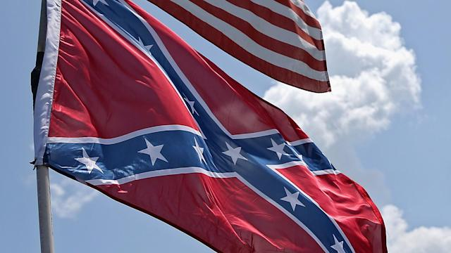 Protesters showed up Sunday morning flying the controversial flag.
