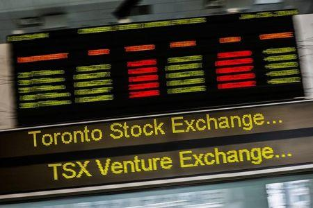 FILE PHOTO: A sign board displaying Toronto Stock Exchange (TSX) stock information is seen in Toronto June 23, 2014.   REUTERS/Mark Blinch