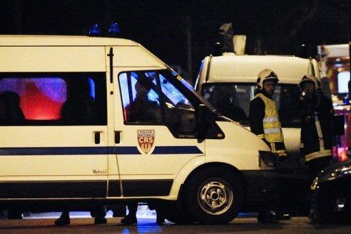 """French police vehicles secure the perimeter of a siege on an apartment block where Mohamed Merah, the man suspected of a series of deadly shootings, was holed up in Toulouse, southwestern France. French police stepped up pressure Thursday on the besieged Al-Qaeda militant who boasted of having """"brought France to its knees"""" with a wave of brutal attacks that left seven dead"""