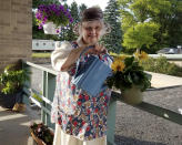 In this photo provided by Sister Mary Jeanine Morozowich, Felician Sister Mary Evelyn Labik waters flowers at St. Anne Home in Greensburg, Pa., on June 22, 2020. Labik died after contracting COVID-19 last October. (Sister Mary Jeanine Morozowich via AP)
