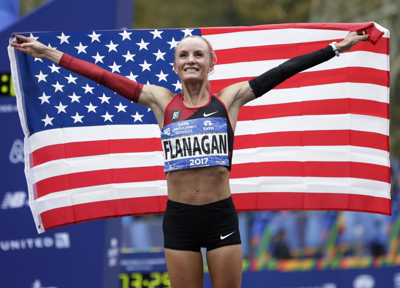 <p>Shalane Flanagan of the United States poses for pictures after crossing the finish line first in the women's division of the New York City Marathon in New York, Nov. 5, 2017. (Photo: Seth Wenig/AP) </p>