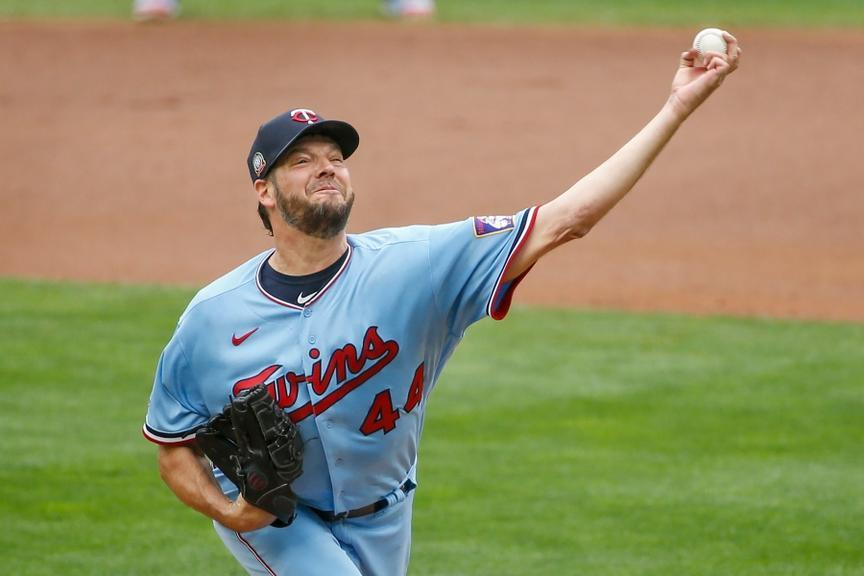 Rich Hill delivers a pitch while wearing the Twins' powder blue uniforms