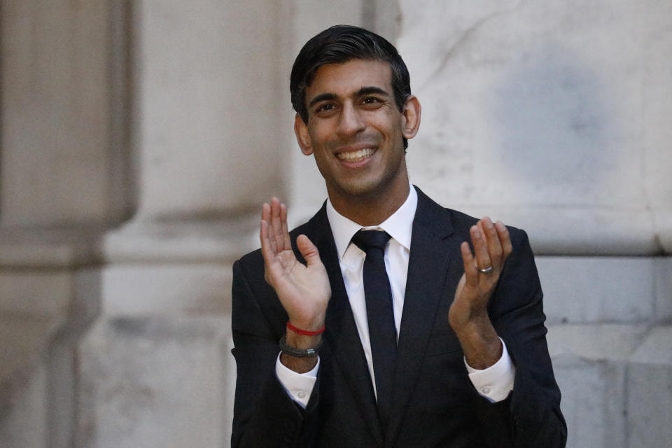 """Britain's Chancellor of the Exchequer Rishi Sunak takes part in a national """"clap for carers"""" to show thanks for the work of Britain's National Health Service (NHS) workers on April 16, 2020 in London, United Kingdom. Photo: Tolga Akmen - WPA Pool/Getty Images)"""