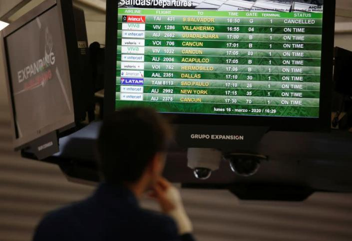 A screen displaying the departures shows the Avianca 431 flight cancelled after El Salvador's President Nayib Bukele accused Mexico of allowing a dozen confirmed coronavirus (COVID-19) cases to board the flight, in Mexico City