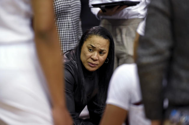 South Carolina coach Dawn Staley speaks to players during the first half of an NCAA college basketball game against South Carolina-Upstate on Thursday, Nov. 21, 2019, in Columbia, S.C. (AP Photo/Richard Shiro)