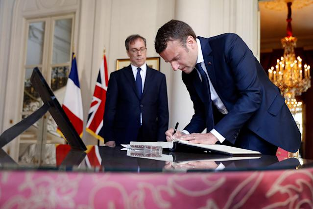 <p>French President Emmanuel Macron (R) signs the book of condolences next to British ambassador Edward Llewellyn (L) at the British Embassy in Paris, France, May 23, 2017, the day after the attack in Manchester. (Etienne Laurent/Pool/Reuters) </p>