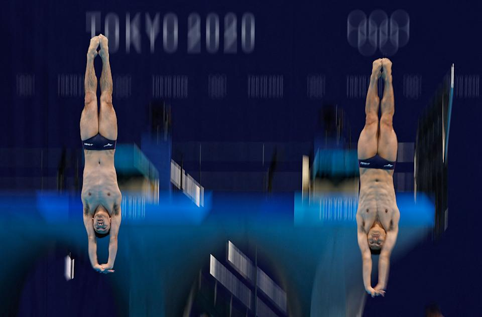 <p>Japan's Ken Terauchi and Japan's Sho Sakai compete in the men's synchronised 3m springboard diving final event during the Tokyo 2020 Olympic Games at the Tokyo Aquatics Centre in Tokyo on July 28, 2021. (Photo by Odd ANDERSEN / AFP)</p>