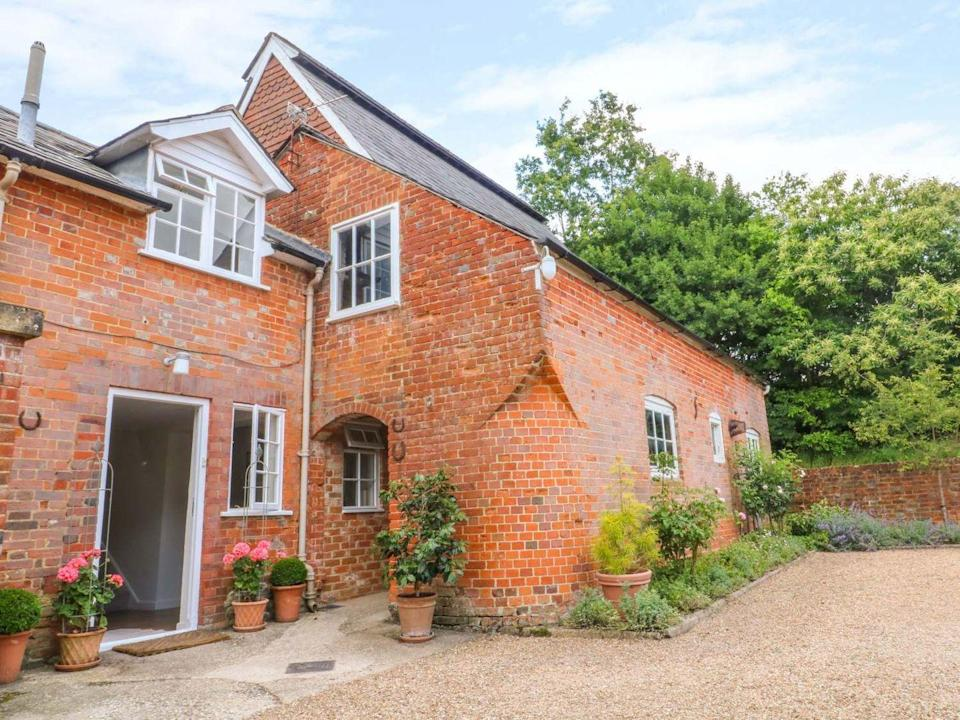"""<p>For a peaceful escape in Hampshire, you'll find Mews Cottage down a quiet country lane in the village of Bentley, just below the church and opposite the vineyard.</p><p>It's a great spot to explore an unspoiled location, with RHS Garden Wisley and Jane Austen's House Museum nearby. Inside, you'll find everything you need for a country cottage break, from comfy sofas to a cute dining area. </p><p><a class=""""link rapid-noclick-resp"""" href=""""https://www.sykescottages.co.uk/cottage/Hampshire-Bentley/Mews-Cottage-1011974.html"""" rel=""""nofollow noopener"""" target=""""_blank"""" data-ylk=""""slk:CHECK AVAILABILITY"""">CHECK AVAILABILITY</a> </p>"""