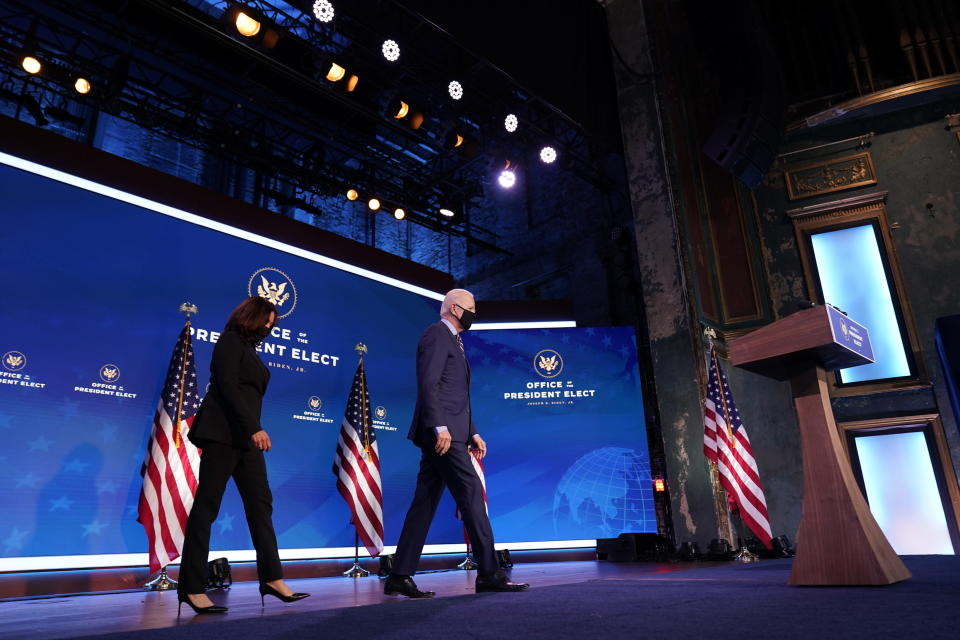 President-elect Joe Biden arrives to speak at The Queen theater, followed by Vice President-elect Kamala Harris, Monday, Dec. 28, 2020, in Wilmington, Del. (AP Photo/Andrew Harnik)