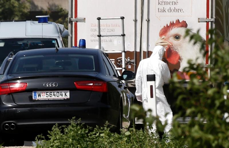 """Austrian motorway maintenance workers first saw the poultry truck on Thursday and noticed """"decomposing body fluids"""" dripping from the vehicle (AFP Photo/Dieter Nagl)"""