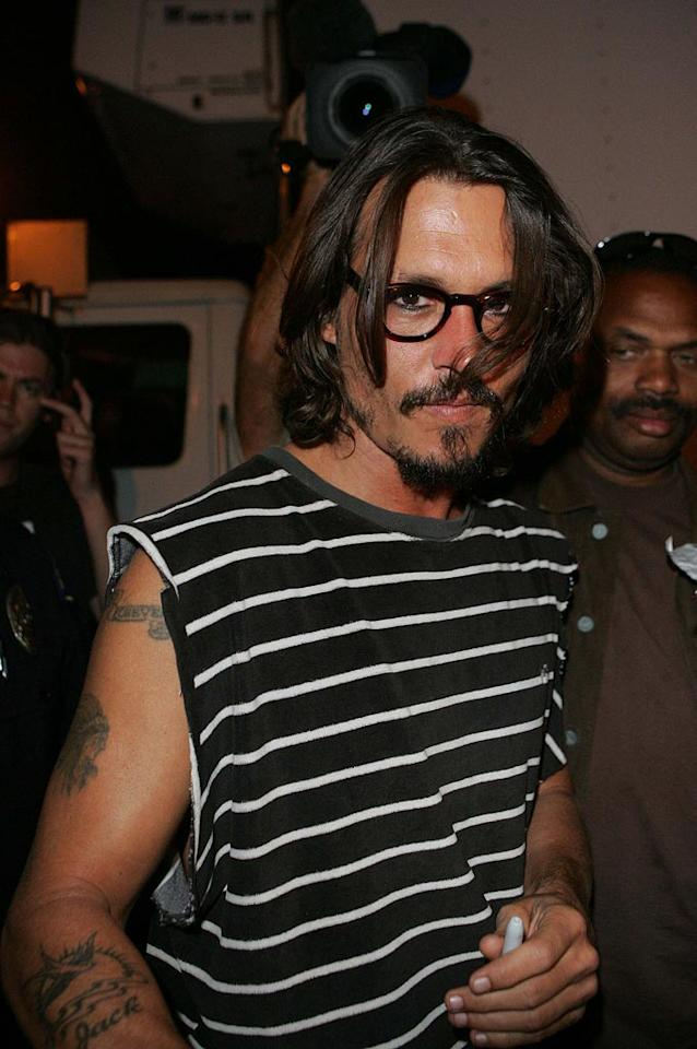 """Johnny Depp is still sexy...even with four eyes. Steinberg/Svitojus/<a href=""""http://www.infdaily.com"""" target=""""new"""">INFDaily.com</a> - August 23, 2006"""
