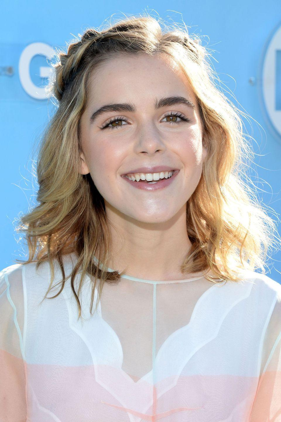 <p>Because sometimes you don't have the energy to fully commit. We get it. Braid two pieces of hair on both sides of her part and secure them together. Easy, breezy, and oh so sweet (just like <em>Chilling Adventures of Sabrina</em>'s <strong>Kiernan Shipka</strong>!).</p>