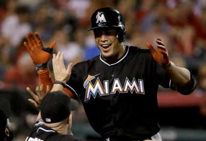 Giancarlo Stanton's deal includes a no-trade clause and an opt-out after six years. (AP)
