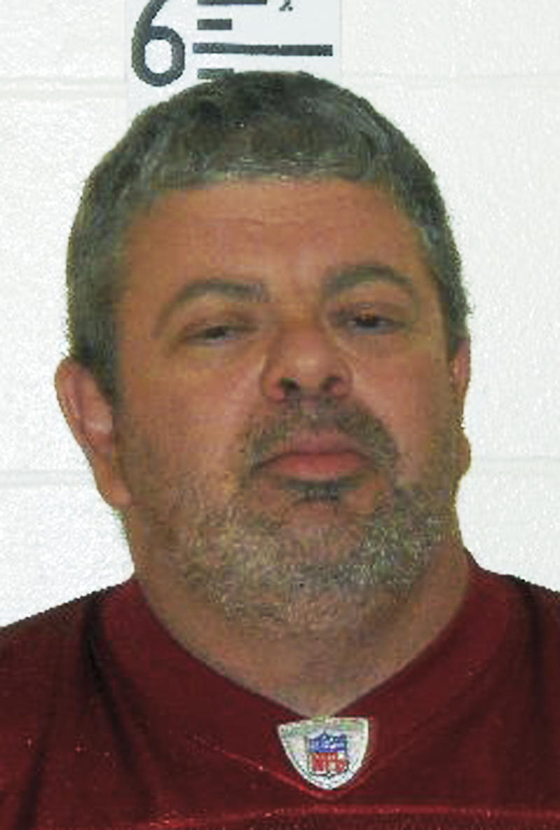 This booking photograph released by the Maine State Police shows Timothy Courtois, who was arrested Sunday, July 22, 2012 on charges of having a concealed weapon and speeding on the Maine Turnpike. Courtois told authorities he was on his way to Derry, N.H., to shoot a former employer. He also said he had attended the Batman movie at the Cinemagic Theater in Saco the previous night. Found in his car were an assault weapon, four handguns and several boxes of ammunition.  A search of his home in Biddeford, Maine, revealed several additional guns, including a machine gun, and thousands of rounds of ammunition.  (AP Photo/Maine State Police)