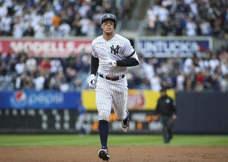 Apr 20, 2019; Bronx, NY, USA; New York Yankees right fielder Aaron Judge (99) rounds second base after hitting a solo home run in the first inning against the Kansas City Royals at Yankee Stadium. Mandatory Credit: Wendell Cruz-USA TODAY Sports