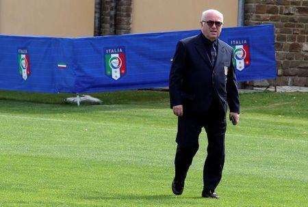 Italian Football Federation President Carlo Tavecchio arrives before the Italy's national soccer team official photo at the Coverciano training center, near Florence, June 1, 2016. REUTERS/Stefano Rellandini/File Photo