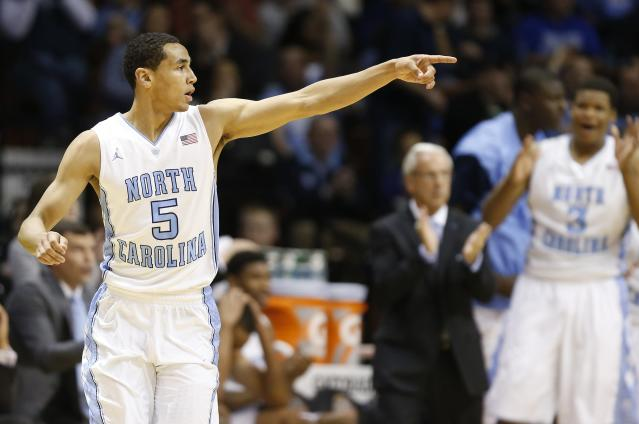 North Carolina's Marcus Paige (5) celebrates after scoring during the second half of an NCAA college basketball game against Richmond in the semifinal round of the Basketball Hall of Fame Tip-Off tournament at Mohegan Sun Arena in Uncasville, Conn., Saturday, Nov. 23, 2013. North Carolina won 82-72. (AP Photo/Michael Dwyer)