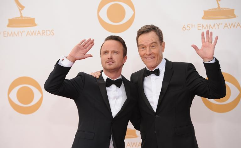 Breaking Bad actors Bryan Cranston (R) and Aaron Paul arrive on the red carpet for the 65th Emmy Awards in Los Angeles, California, on September 22, 2013