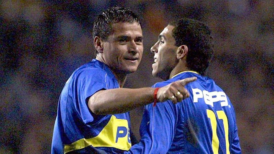 Marcelo Delgado y Carlos Tevez | AFP/Getty Images