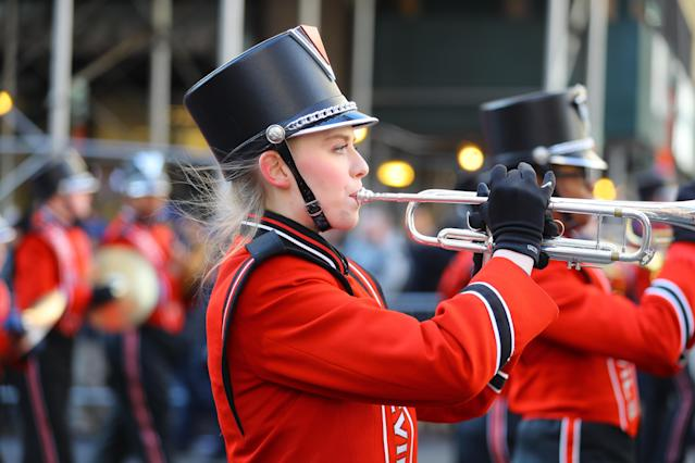 <p>A member of the Hinsdale Central High School Red Devil Marching Band from Hinsdale, Ill. performs during the Veterans Day parade in New York on Nov. 11, 2017. (Photo: Gordon Donovan/Yahoo News) </p>