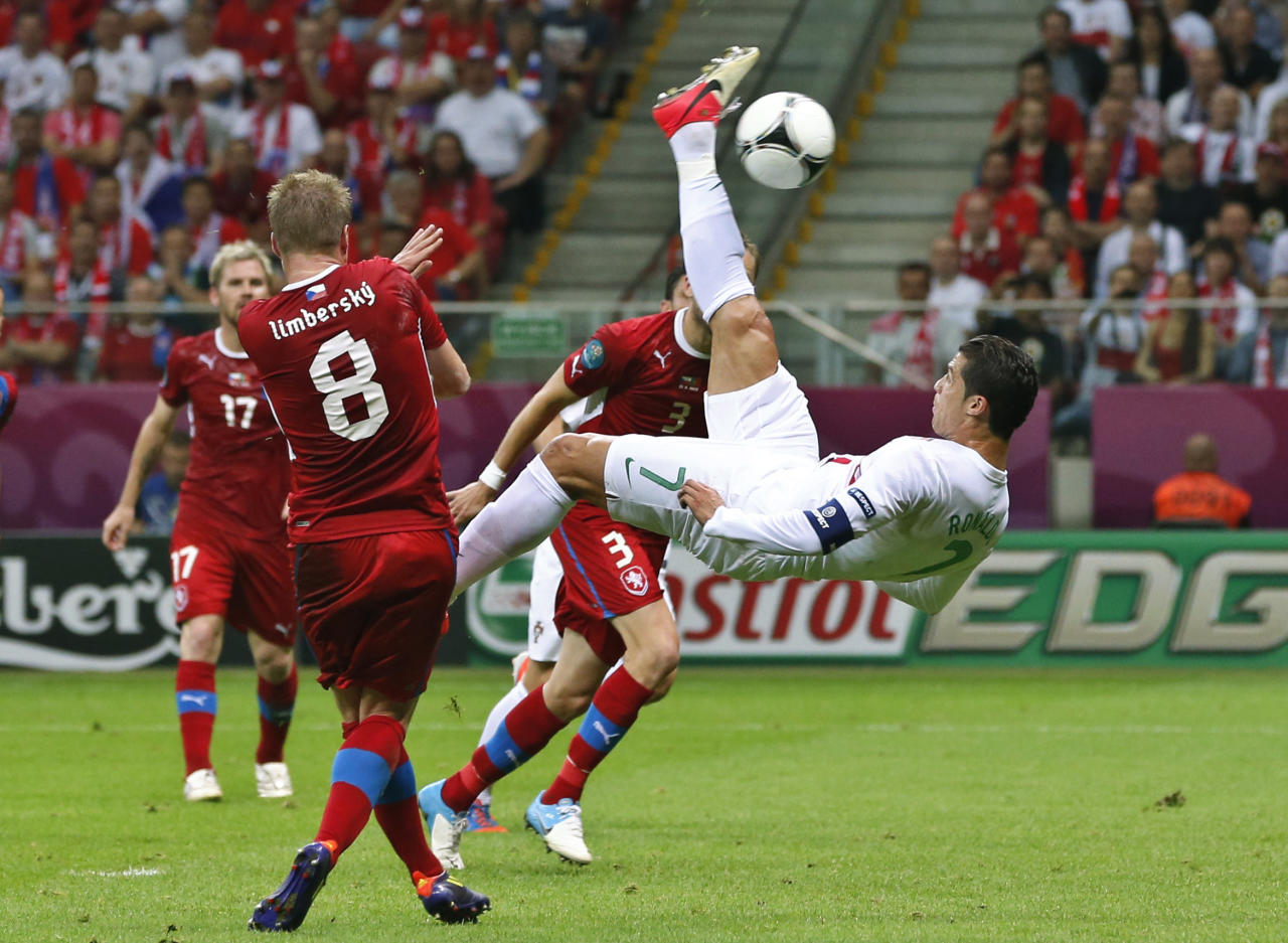 Portugal's Cristiano Ronaldo tries an overhead shot by Czech Republic's David Limbersky during the Euro 2012 soccer championship quarterfinal match between Czech Republic and Portugal in Warsaw, Poland, Thursday, June 21, 2012. (AP Photo/Petr David Josek)
