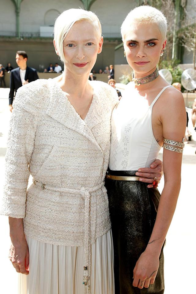<p>Delevingne spent some time catching up with Swinton — another woman rocking short bleach blonde hair — at Chanel. (Photo by Bertrand Rindoff Petroff/Getty Images) </p>
