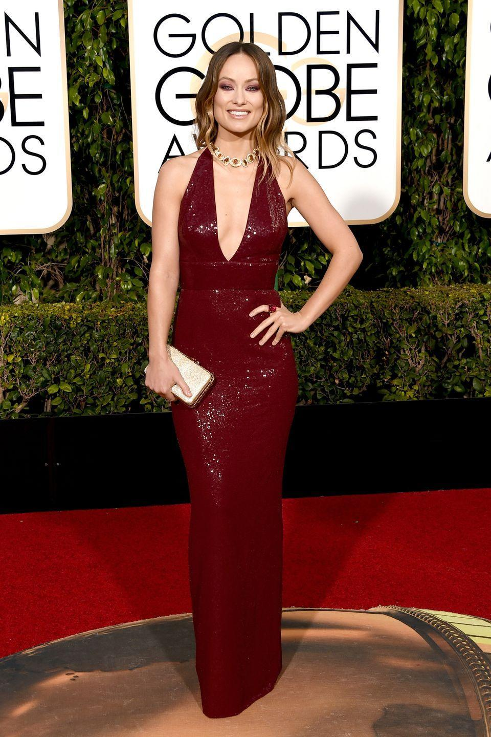 <p>Wilde always eschews typical red carpet trends, and makes a statement of her own, as she did in this oxblood sequin Michael Kors gown in 2016. </p>