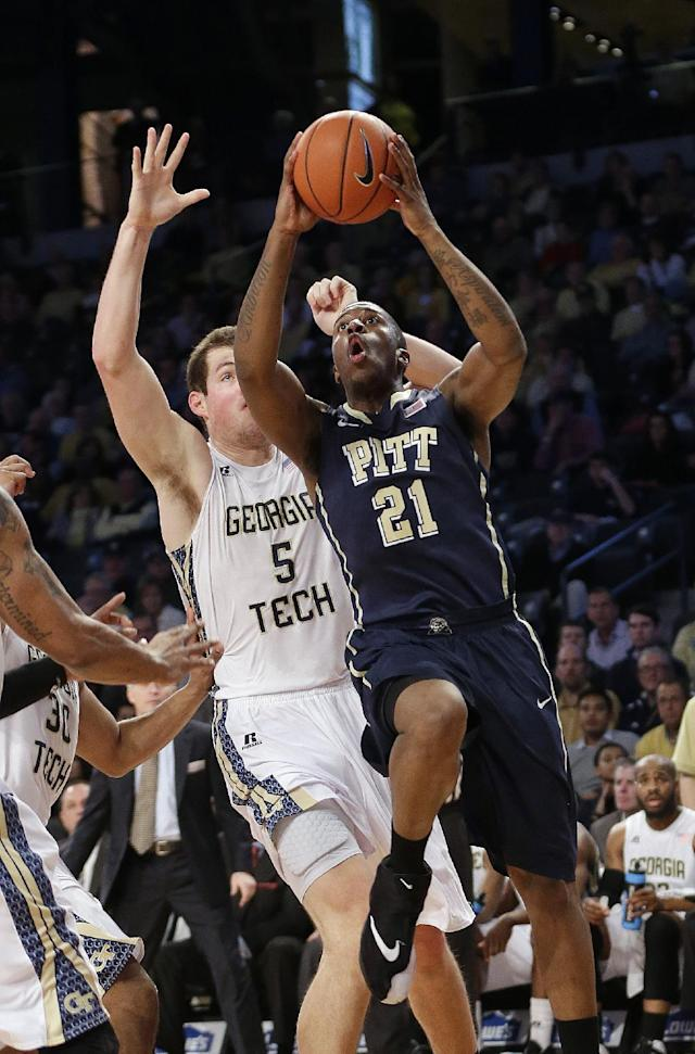 Pittsburgh forward Lamar Patterson (21) drives as Georgia Tech center Daniel Miller (5) defends in the first half of an NCAA college basketball game, Tuesday, Jan. 14, 2014, in Atlanta. (AP Photo/John Bazemore)