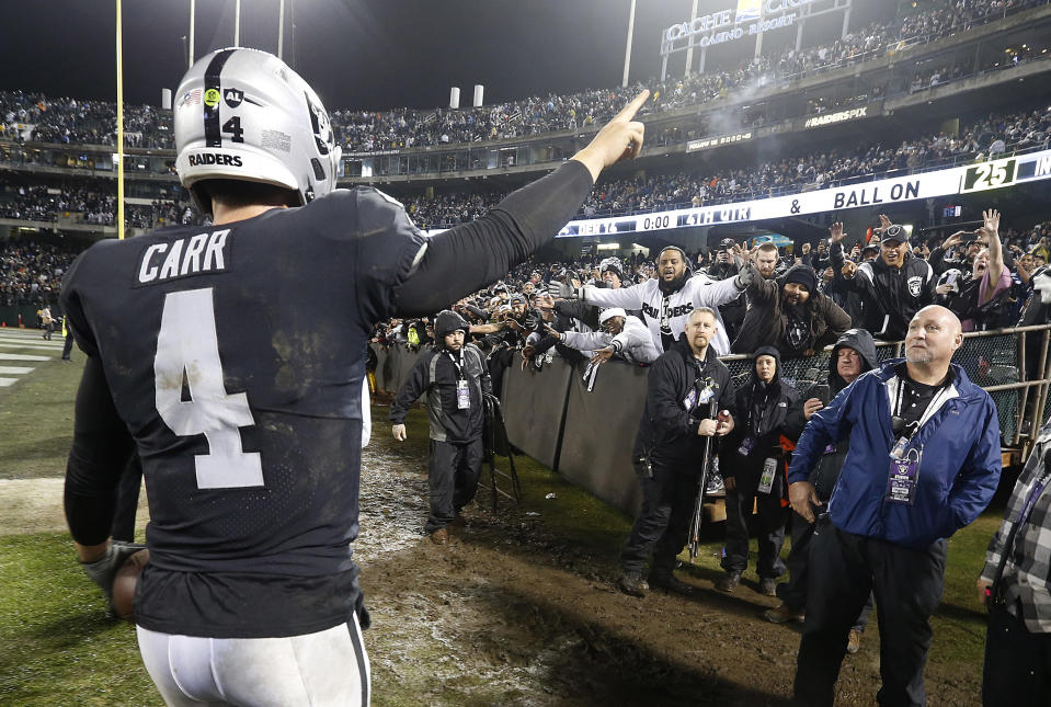 Derek Carr stuck around after the game to say thanks to Raiders fans. (AP)