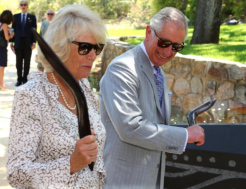 Camilla Parker Bowles and Prince Charles wielding boomerangs during a visit to Kings Park in Perth, Australia, November 2015.