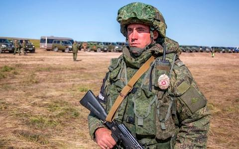 A Russian soldier guards an area during the military exercises in the Chita region, Eastern Siberia - Credit: Russian Defense Ministry Press Service