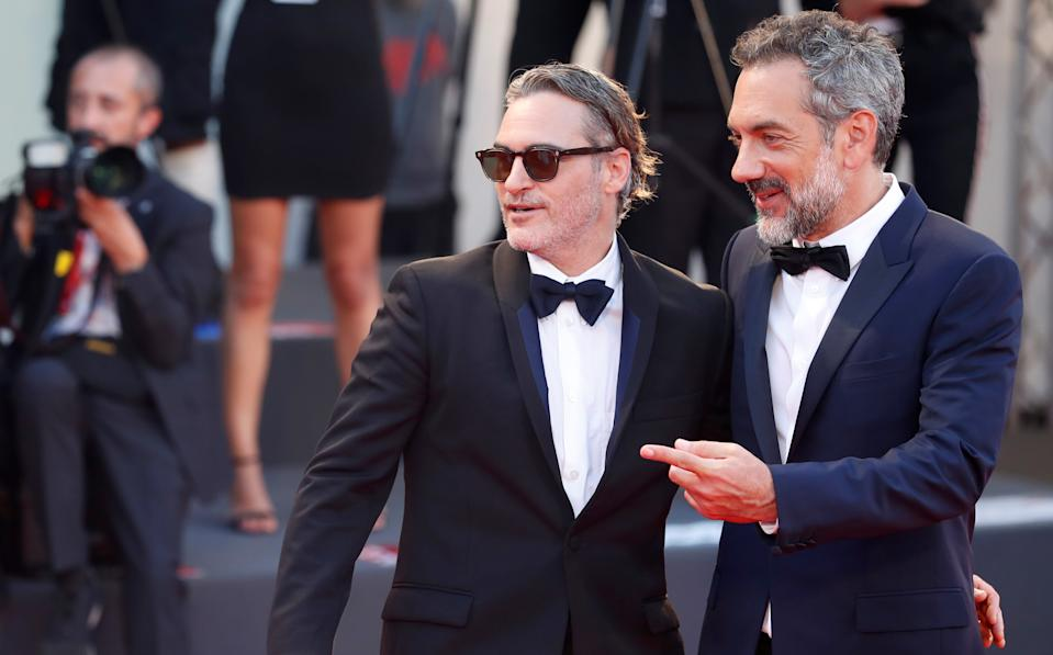 """The 76th Venice Film Festival - Screening of the film """"Joker"""" in competition - Red Carpet Arrivals- Venice, Italy, August 31, 2019 - Cast member Joaquin Phoenix and director Todd Phillips pose. REUTERS/Yara Nardi"""