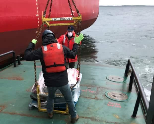 Community members wrapped the care package in shrink wrap and sent it to the ship with medical staff doing a routine check on the crew.