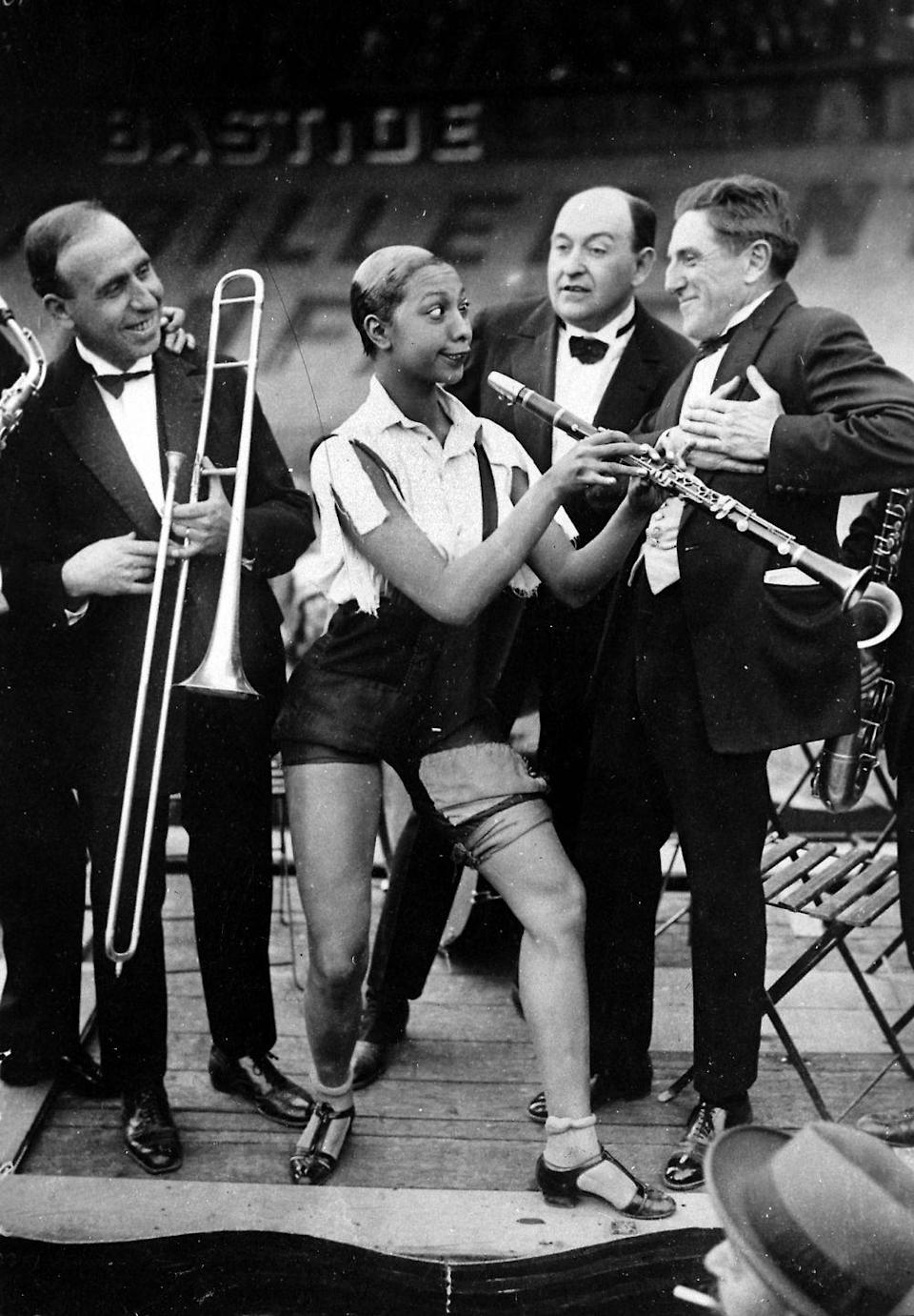 """<p>At the age of 13, Baker ran away in hopes of becoming a dancer. She found work <a href=""""https://www.stltoday.com/entertainment/books-and-literature/josephine-baker-a-diva-who-embraced-the-world/article_2f021e35-4c81-5388-a537-b4dcee3f3503.html"""" rel=""""nofollow noopener"""" target=""""_blank"""" data-ylk=""""slk:waitressing at the Old Chauffeur's Club"""" class=""""link rapid-noclick-resp"""">waitressing at the Old Chauffeur's Club</a> and dancing on the street for money. In 1919, she landed her big break: Touring the country as a dancer with the Jones Family Band and the Dixie Steppers.</p>"""