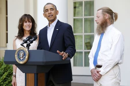 U.S. President Barack Obama stands with the parents of U.S. Army Sergeant Bergdahl at the White House in Washington