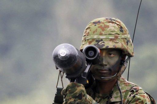 A Japan soldier aims an anti-tank missile during a military exercise at the Higashi-Fuji training range in 2011. South Korea has postponed at the last minute the signing of a landmark military agreement with Japan, amid anger in Seoul over the planned pact with a former colonial ruler