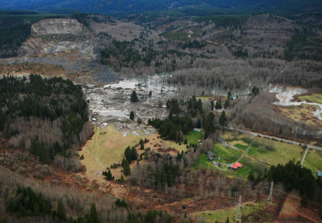This March 23, 2014 photo, made available by the Washington State Dept of Transportation shows a view of the damage from Saturday's mudslide near Oso, Wash. At least eight people were killed in the 1-square-mile slide that hit in a rural area about 55 miles northeast of Seattle on Saturday. Several people also were critically injured, and about 30 homes were destroyed. (AP Photo/Washington State Dept of Transportation)