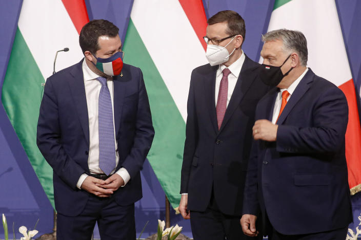 Hungarian prime minister Viktor Orban, right, Poland's prime minister, Matteusz Morawiecki, center, and former interior minister of Italy, Matteo Salvini speak after a joint press conference in Budapest, Hungary, Thursday, April 1, 2021. Hungarian prime minister Viktor Orban hosted talks with right-wing politicians, Poland's prime minister, Matteusz Morawiecki, and former interior minister of Italy, Matteo Salvini, a potential opening step toward a new populist political force on the European stage. (AP Photo/Laszlo Balogh)