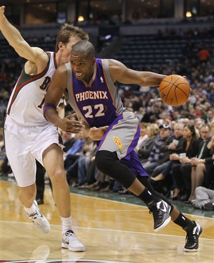 Phoenix Suns' Michael Redd (22) drives past Milwaukee Bucks' Mike Dunleavy, left, during the first half of an NBA basketball game on Tuesday, Feb. 7, 2012, in Milwaukee. (AP Photo/Jeffrey Phelps)