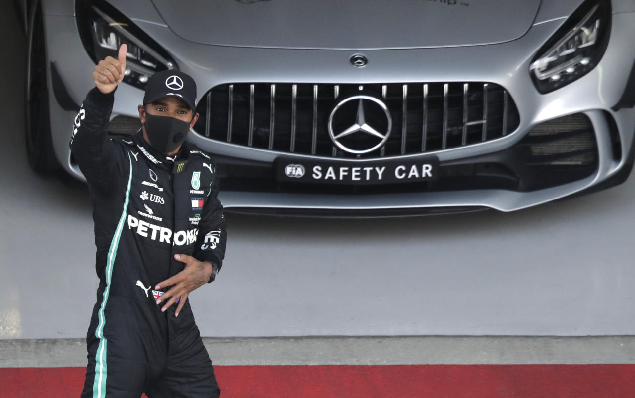 Mercedes driver Lewis Hamilton of Britain gives the thumbs up after clocking the fastest time during the qualifying session for the upcoming Russian Formula One Grand Prix, at the Sochi Autodrom circuit, in Sochi, Russia, Saturday, Sept. 26, 2020. The Russian Formula One Grand Prix will take place on Sunday. Hamilton will start in pole position for Sunday's race. (AP Photo/Pavel Golovkin, Pool)