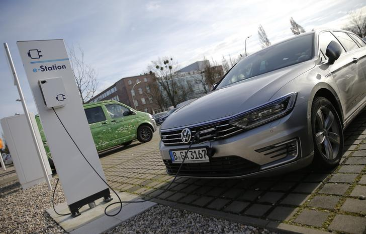 An electric Volkswagen Passat car is pictured at charging station at a VW dealer in Berlin