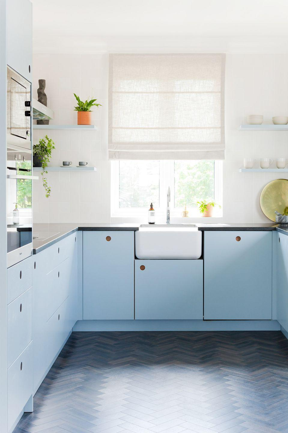 <p>If you're renovating your kitchen and want to customize cabinetry, consider hardware-free cabinets like the ones in this space designed by 2LG Studio. The round built-in handles introduce softness and consistency. </p>