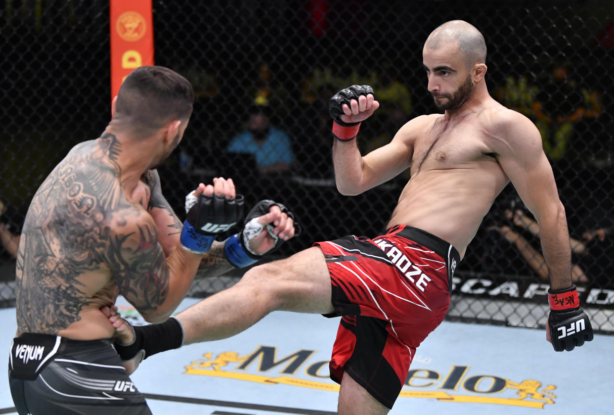 LAS VEGAS, NEVADA - MAY 01: (R-L) Giga Chikadze of Georgia kicks Cub Swanson in a featherweight bout during the UFC Fight Night event at UFC APEX on May 01, 2021 in Las Vegas, Nevada. (Photo by Jeff Bottari/Zuffa LLC)