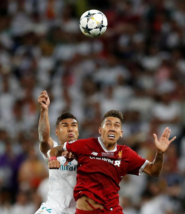 Soccer Football - Champions League Final - Real Madrid v Liverpool - NSC Olympic Stadium, Kiev, Ukraine - May 26, 2018 Real Madrid's Casemiro clashes with Liverpool's Roberto Firmino REUTERS/Andrew Boyers TPX IMAGES OF THE DAY