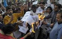 NOIDA, INDIA - DECEMBER 11: Congress party workers burn a copy of the proposed bill during a protest against the BJP and the Citizenship Amendment Bill (CAB) at Sector 18, on December 11, 2019 in Noida, India. Normal life came to a halt on Tuesday in several states amid protests over the Citizenship (Amendment) Bill. The Bill, piloted by Union home minister Amit Shah, was comfortably passed in the Lok Sabha on Monday night. Home Minister Amit Shah on Wednesday moved the Citizenship (Amendment) Bill in the Rajya Sabha and sought to assuage the concerns of Indian Muslims by saying they have nothing to fear as they are and will remain citizens of India. (Photo by Sunil Ghosh/Hindustan Times via Getty Images)