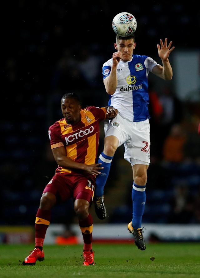 "Soccer Football - League One - Blackburn Rovers vs Bradford City - Ewood Park, Blackburn, Britain - March 29, 2018 Blackburn Rovers Darragh Lenihan in action with Bradford City's Dominic Poleon Action Images/Jason Cairnduff EDITORIAL USE ONLY. No use with unauthorized audio, video, data, fixture lists, club/league logos or ""live"" services. Online in-match use limited to 75 images, no video emulation. No use in betting, games or single club/league/player publications. Please contact your account representative for further details."