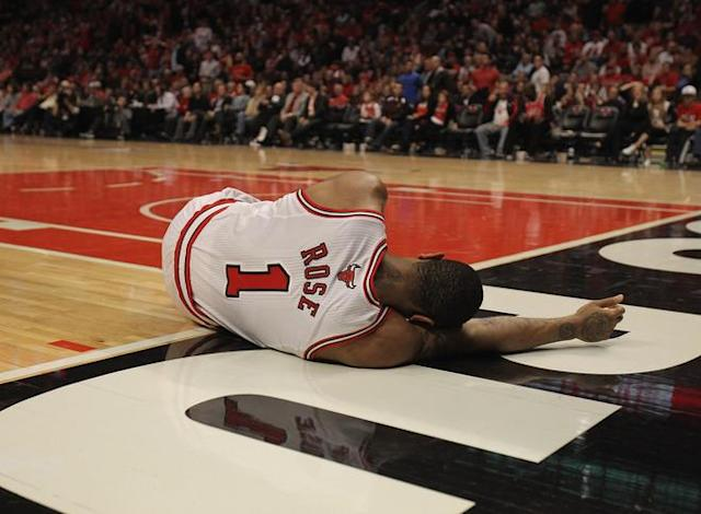 CHICAGO, IL - APRIL 28: Derrick Rose #1 of the Chicago Bulls lays on the floor aftrer suffering an injury against the Philadelphia 76ers in Game One of the Eastern Conference Quarterfinals during the 2012 NBA Playoffs at the United Center on April 28, 2012 in Chicago, Illinois. The Bulls defeated the 76ers 103-91. NOTE TO USER: User expressly acknowledges and agrees that, by downloading and or using this photograph, User is consenting to the terms and conditions of the Getty Images License Agreement. (Photo by Jonathan Daniel/Getty Images)