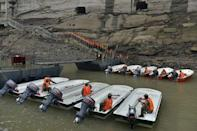 Paramilitary policemen assemble to get ready to travel to Hubei province for rescue operations after a ship sank in the Jianli section of the Yangtze River, at a port in Chongqing, June 2, 2015. REUTERS/Stringer